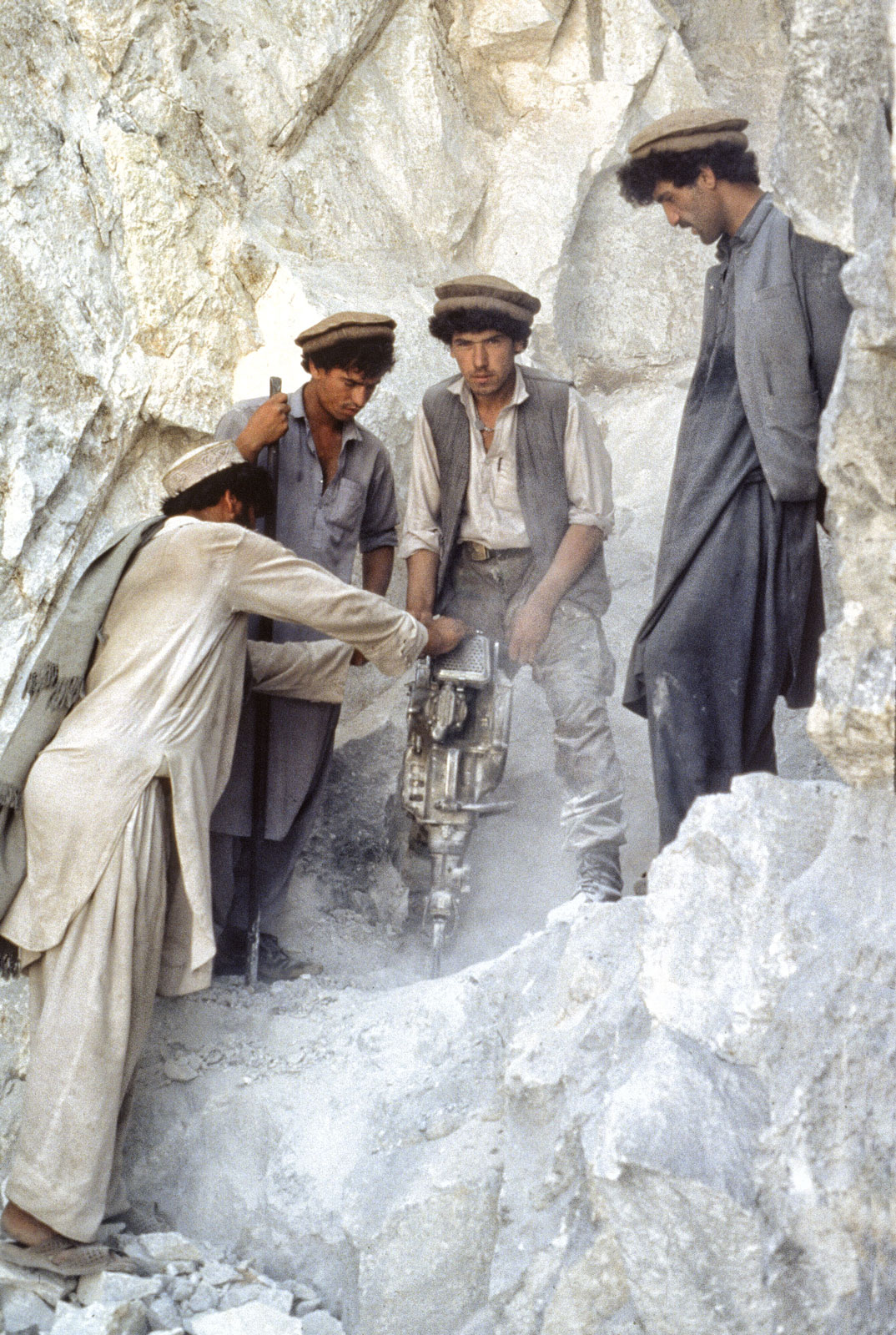 Afghan miners drilling the limestone for rubies at Jegdalek, Afghanistan. (Photo: Gary Bowersox)