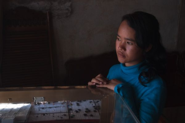 Young lady in a Pailin dealer's shop