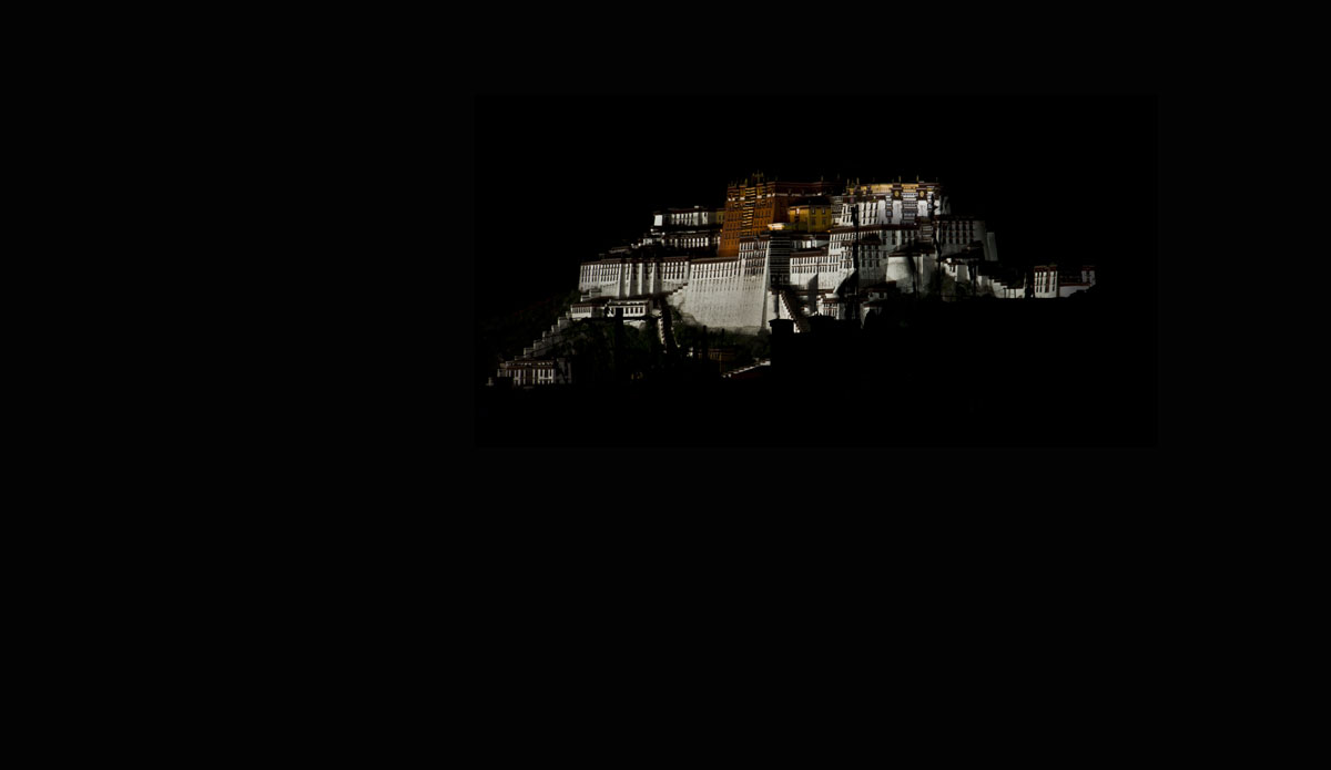 Perfect darkness Lhasa's Potala palace floats ghostlike above the darkened city. Photo: Billie Hughes