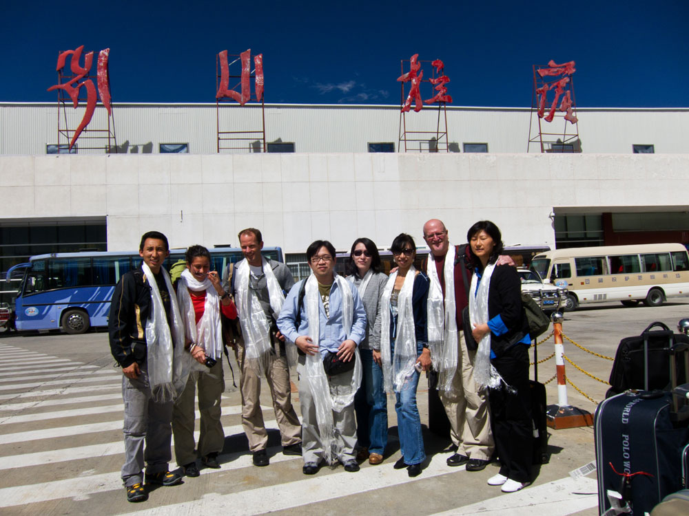 Figure 2. Team Tibet 2010 on arrival at Lhasa airport. From left to right: Ahmadjan Abduriyim, Flavie Isatelle, Brendan Laurs, Thanong Leelawatanasuk, Young Sze Man, Christina Iu, Richard Hughes and Lou Li Ping.