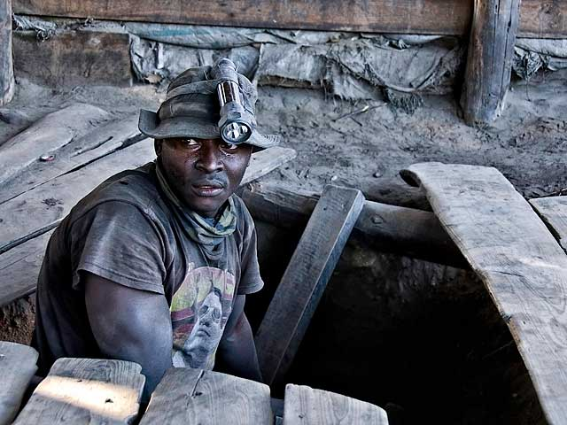 A graphite-coated miner emerges from the shaft at Merelani's Block D. Photo © Richard W. Hughes.