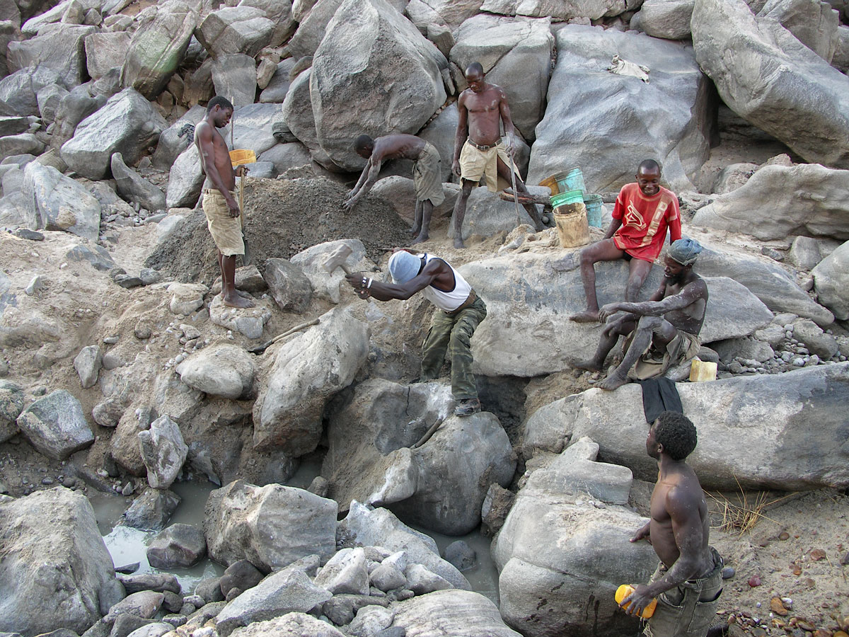 Miners work the dry riverbed at the Muhuwesi river in Tanzania's Tunduru district.