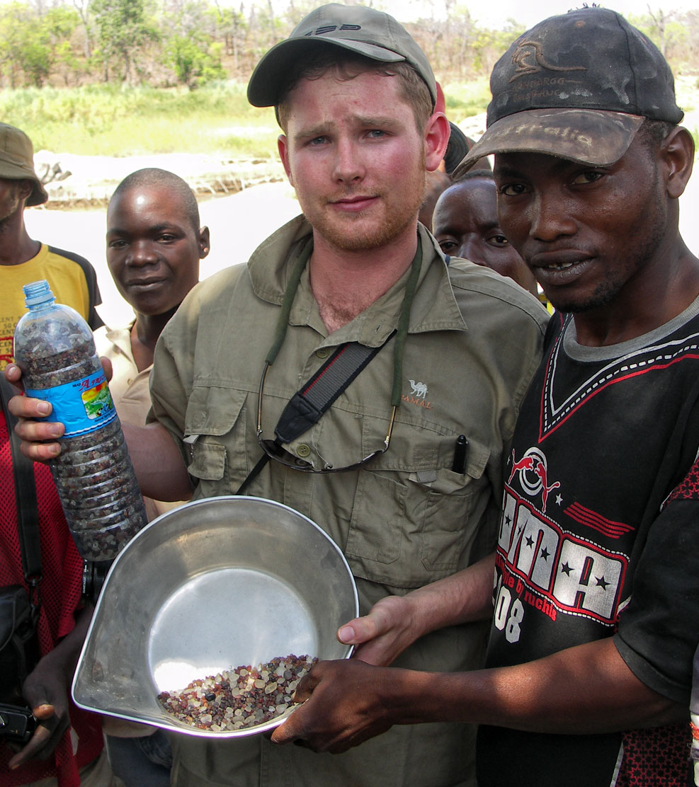 Warne Chitty along with a group of friendly natives along the Muhuwesi river in Tanzania's Tunduru district
