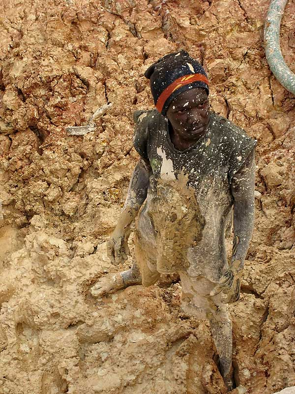 A mud-spattered sapphire miner at Ngembambili Amanimakoro, Songea. Richard Hughes, Lotus Gemology.