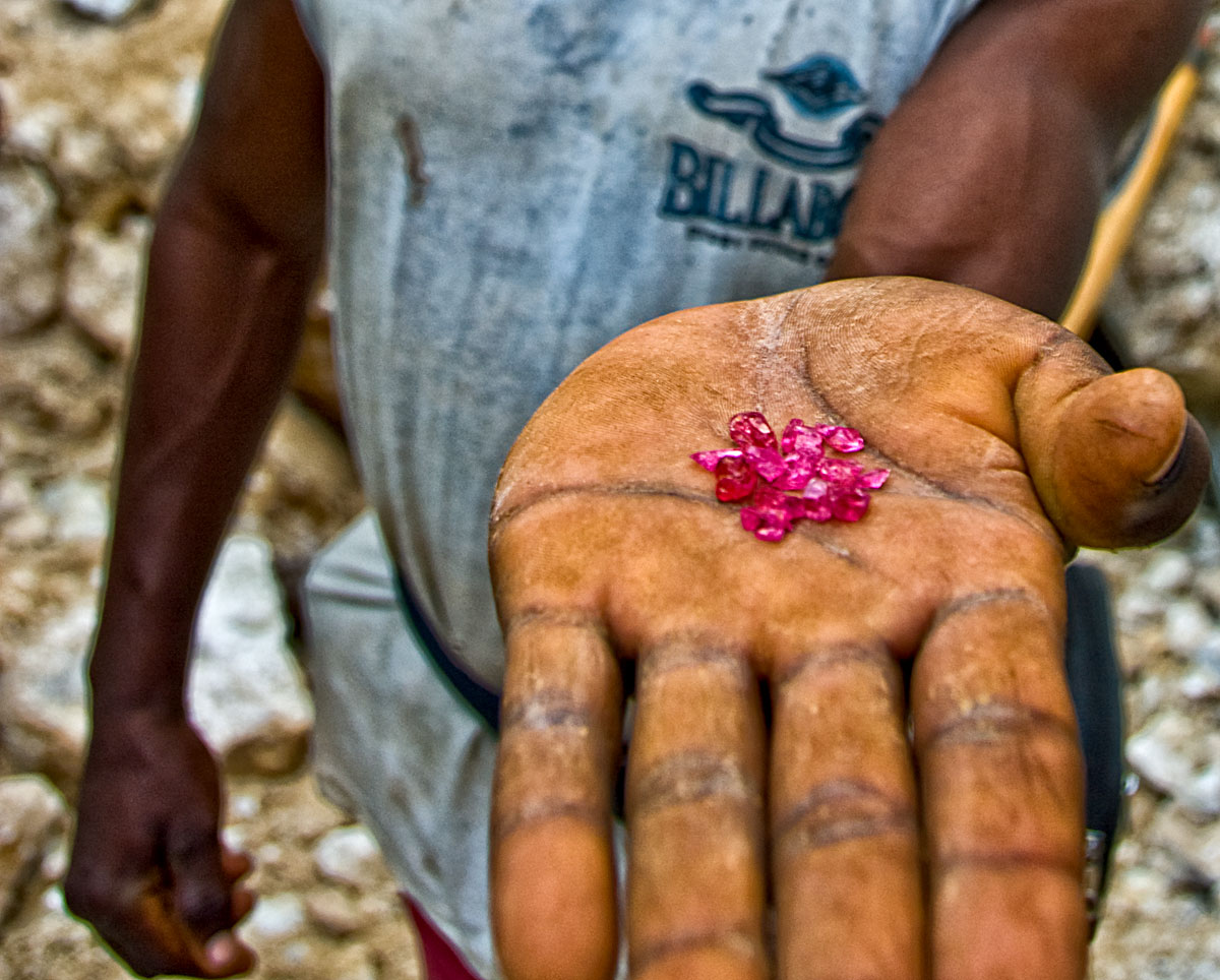 The fruit of excruciating labor, a handful of fine red spinels from Ipanko, near Mahenge. Photo: Richard Hughes, Lotus Gemology.