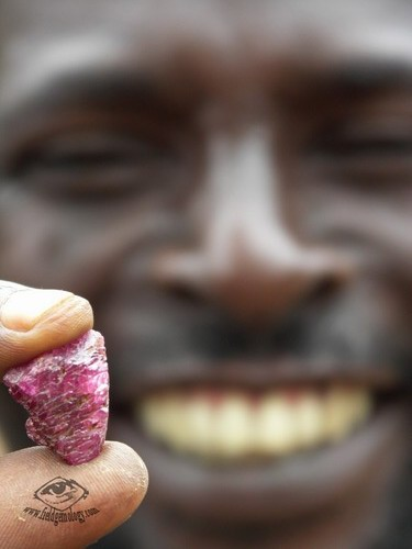 Mr. Esperitus, displaying his ruby find at Lukande, near Mahenge. He was responsible for first discovering the spinel mines at Ipanko.