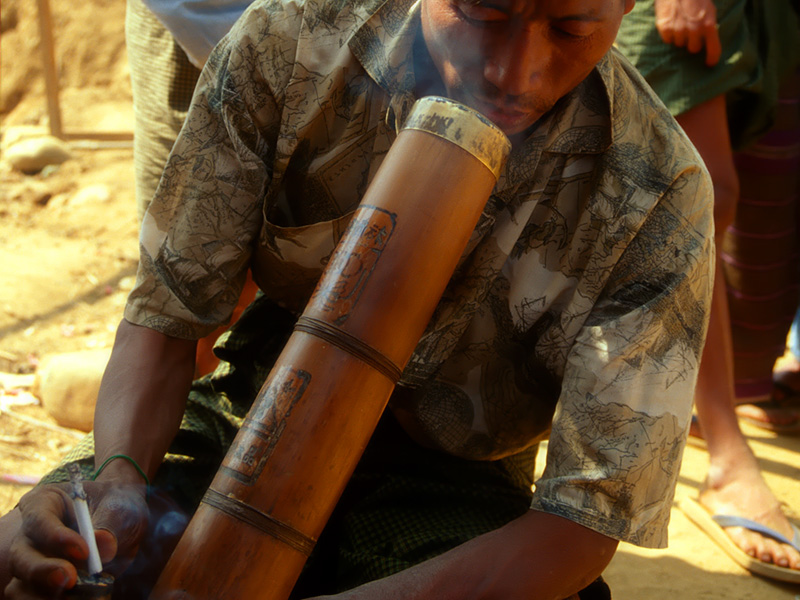 A miner takes a break to have a cigarette at Hpakangyi. Such Chinese bamboo water pipes (bongs) are also used for smoking opium, to which many miners are addicted. Inset: Despite its toughness, much jade is polished on bamboo lathes, such as this one in Mandalay's jade market.