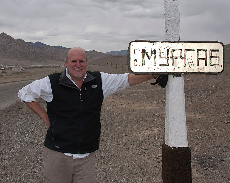 The author on the outskirts of Murgab, in the remote Badakhshan region of Tajikistan. Imagine a photo of you next to the sign.