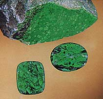 "Figure B-3. A ""cousin"" to jade, maw-sit-sit is an attractive ornamental stone that is an intergrowth mainly of albite, clinochlore, kosmochlor, chromian jadeite, and eckermannitic amphibole. These two maw-sit-sit cabochons weigh 9.87 ct (oval) and 8.48 ct. Courtesy of Pala International; photo © Harold & Erica Van Pelt."