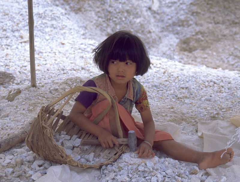 A young girl breaks marble in search of rubies at Kyauk Saung, in the Mogok Stone Tract. She told the author it was her summer holiday, and that she would be back in school in a few days.