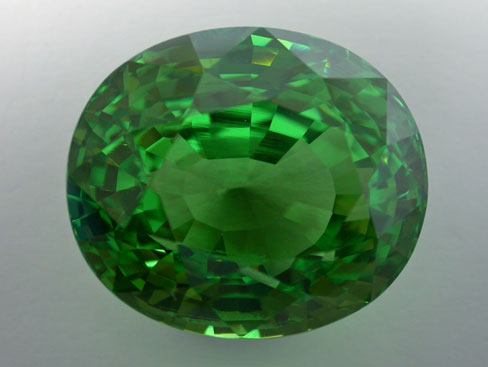 If large clean tsavorites are rare, this gem weighting more than 40 carats is truly an exceptional stone. Believed to have been found at the Karo mine in Merelani, Tanzania, the stone's only visible inclusions using the microscope are the growth lines we can see near the center of this incredible gem.  Stone courtesy Multicolour.com; Photo: V. Pardieu/AIGS, 2004.